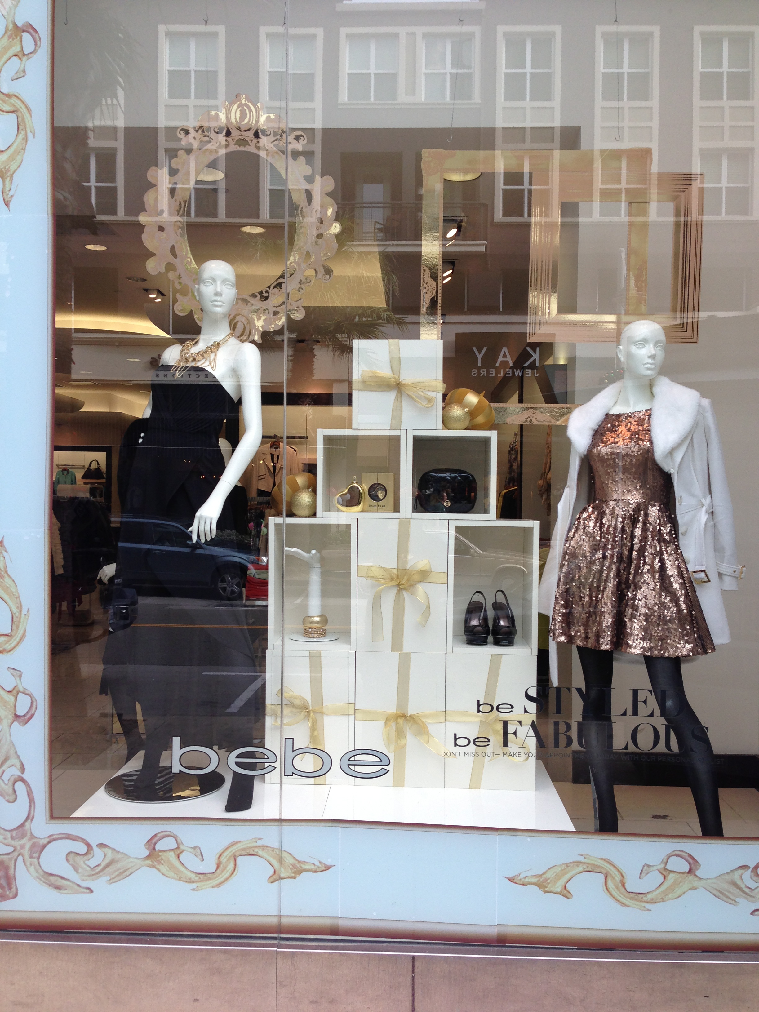 Budget friendly holiday window display for retailers idea for Retail store window display ideas