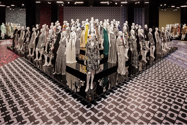 """ba94297807903 Over 200 mannequins on tiered platforms were used for the exhibition in  LosAngeles """"Journey of a Dress"""" celebrating the 40th anniversary of the wrap  dress ..."""