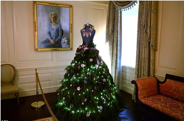 these dress form trees feature one of a kind skirts with evergreen adornments and frosted embellishments