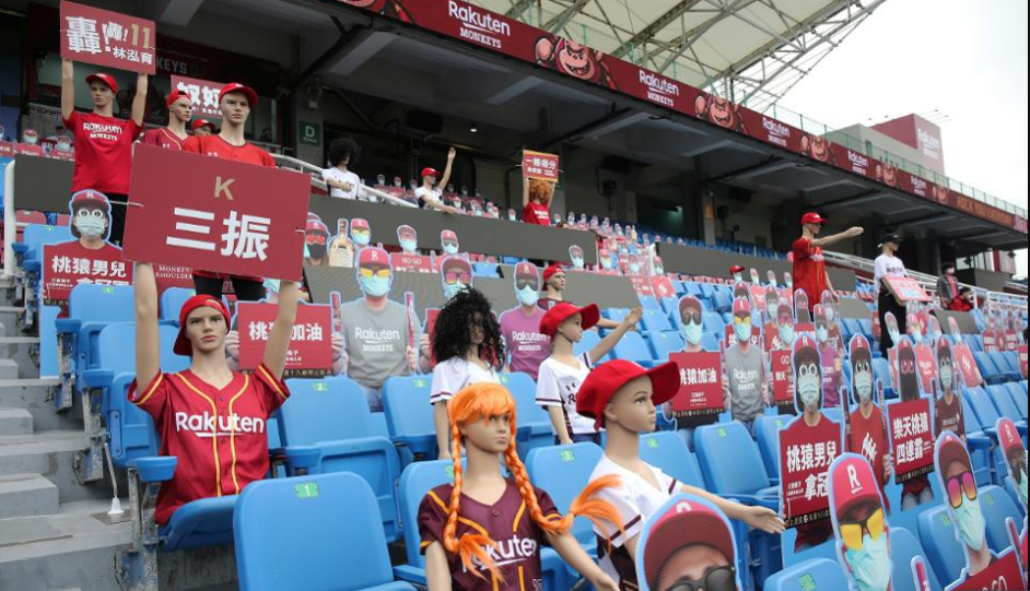 Mannequins and fake masked audience placards are placed at the Taoyuan Baseball stadium before the ... [+]